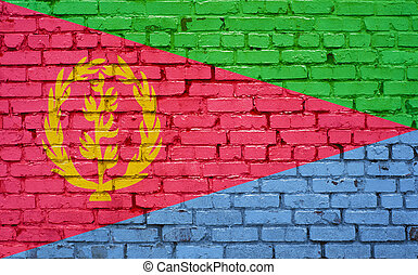 Flag of Eritrea painted on brick wall, background texture