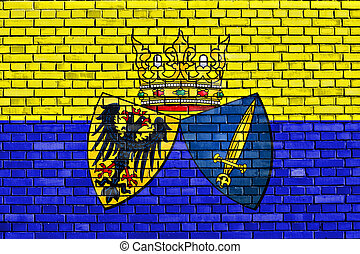 flag of Essen painted on brick wall