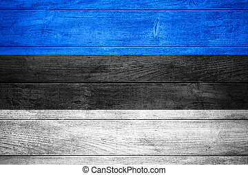 flag of Estonia or Estonian banner on wooden background