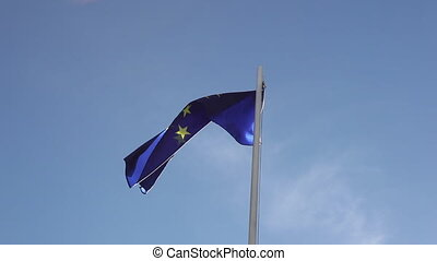 Flag of European Union in front of blue sky