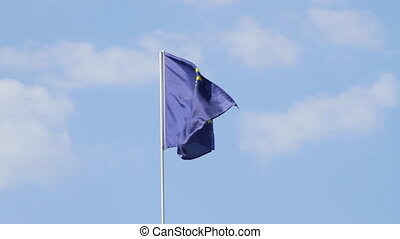 Flag of European Union on the blue sky