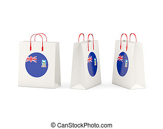 Round flag of falkland islands on shopping bags. 3D illustration
