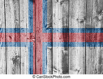 Flag of Faroe Islands on weathered wood