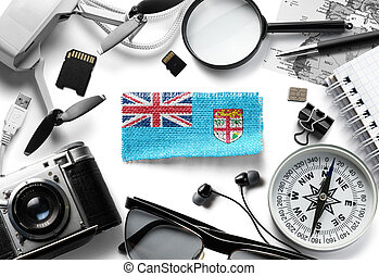Flag of Fiji and travel accessories on a white background. The view from the top.