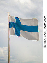 Flag of Finland on a blue sky with clouds background
