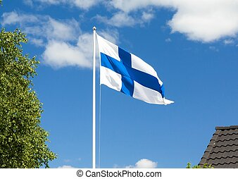 Flag of Finland on sky background.