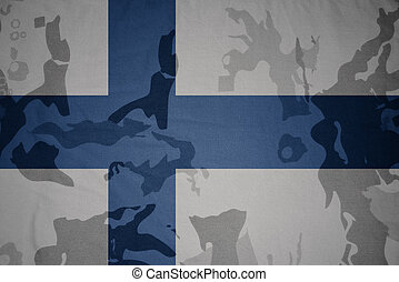 flag of finland on the khaki texture . military concept