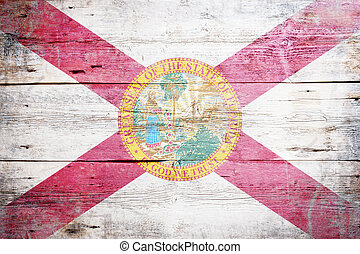 Flag of Florida painted on grungy wooden background