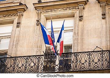 Flag of France fluttering under a serene blue sky - Flag of...