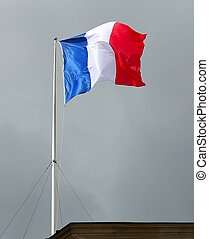 Flag of France, waving in the wind, in the sky
