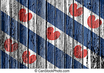 flag of Friesland painted on wooden frame