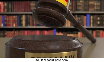 Flag on falling judge's gavel in court. National justice related conceptual 3D