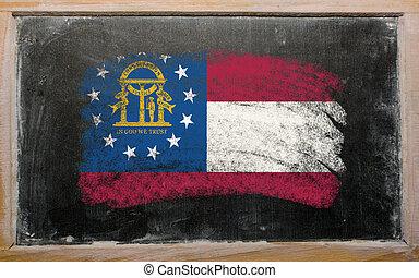 flag of Georgia on blackboard painted with chalk