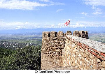 Flag of Georgia on medieval fortress wall, Sighnaghi, Georgia