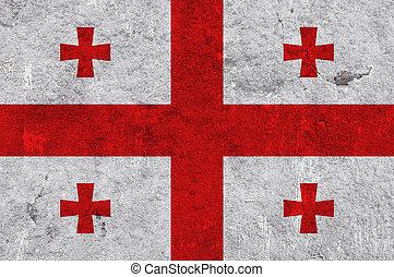 Flag of Georgia on weathered concrete