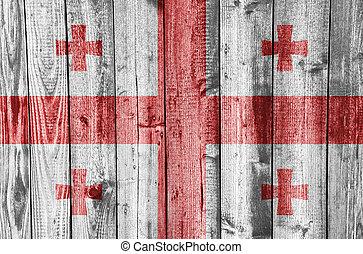 Flag of Georgia on weathered wood