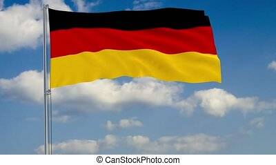 Flag of Germany against background of clouds sky