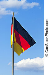 Flag of Germany against the blue sky