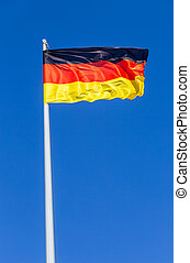 Flag of Germany flying in the wind against the sky