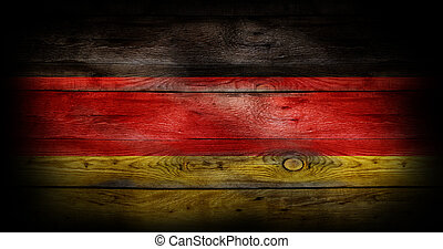 Flag of Germany painted on grungy wood plank background