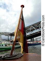 flag of Germany at the rear of a barge