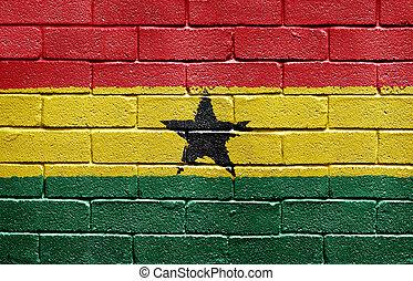 Flag of Ghana on brick wall