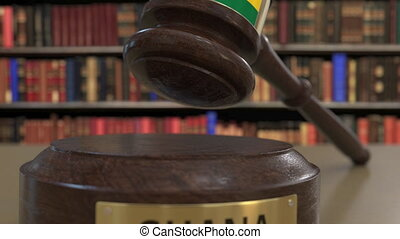 Flag of Ghana on falling judges gavel in court. National...