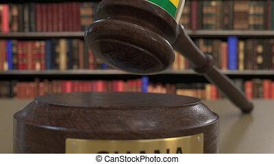 Flag of Ghana on falling judges gavel in court. National...