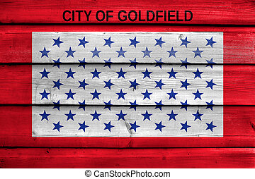 Flag of Goldfield, Colorado, USA, painted on old wood plank background