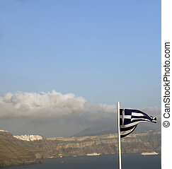 flag of Greece flying over the caldera Oia Santorini