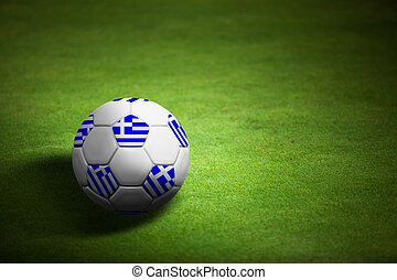 Flag of Greece with soccer ball over grass background - Euro...