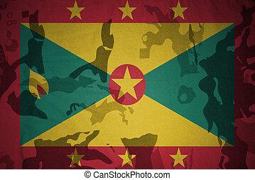 flag of grenada on the khaki texture . military concept