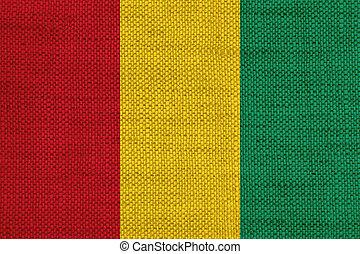 Flag of Guinea on old linen