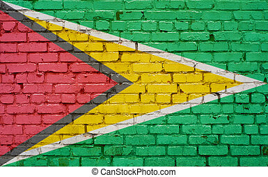 Flag of Guyana painted on brick wall, background texture
