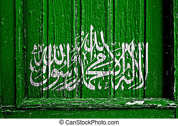 flag of Hamas painted on wooden frame