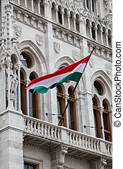 Flag of Hungary waving on wind on parliament wall