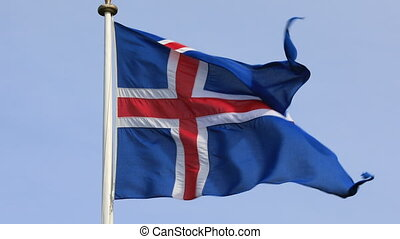 Flag of Iceland - Iceland flag gently waving in wind against...