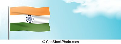 Flag of India waving on a blue sky background. - The ...