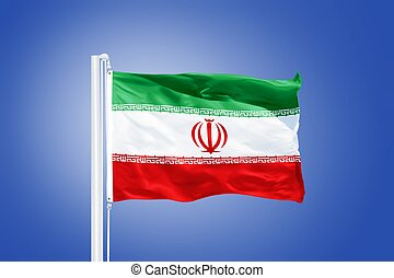 Flag of Iran flying against a blue sky