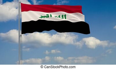 Flag of Iraq against background of clouds sky