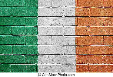 Flag of Ireland on brick wall - Flag of Ireland painted onto...