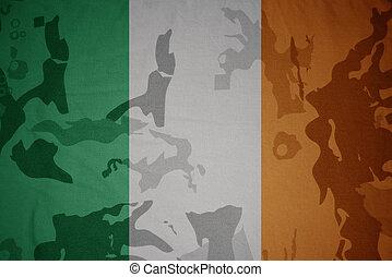 flag of ireland on the khaki texture . military concept