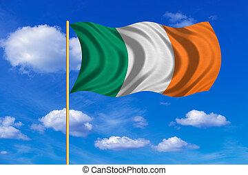 Flag of Ireland waving on blue sky background
