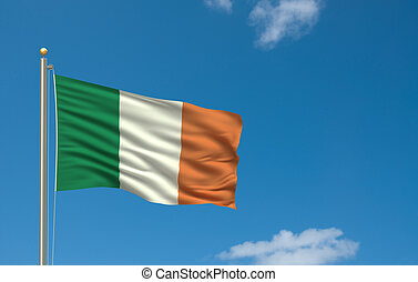 Flag of Ireland with flag pole waving in the wind on front of blue sky