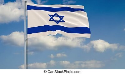Flag of Israel against background of clouds floating on the blue sky