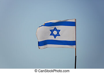 Flag of Israel against the background of the sky