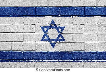 Flag of Israel on brick wall