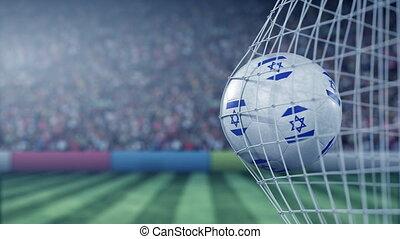 Flag of Israel on the football hitting goal net back....