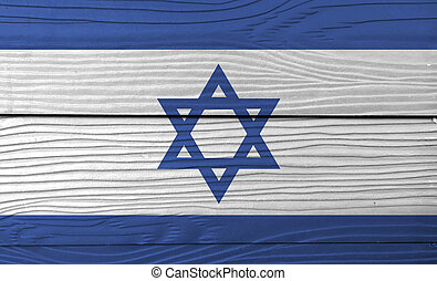 Flag of Israel on wooden wall background. Grunge Israeli flag texture, blue hexagram on a white background, between two blue stripes.