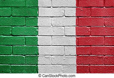 Flag of Italy on brick wall
